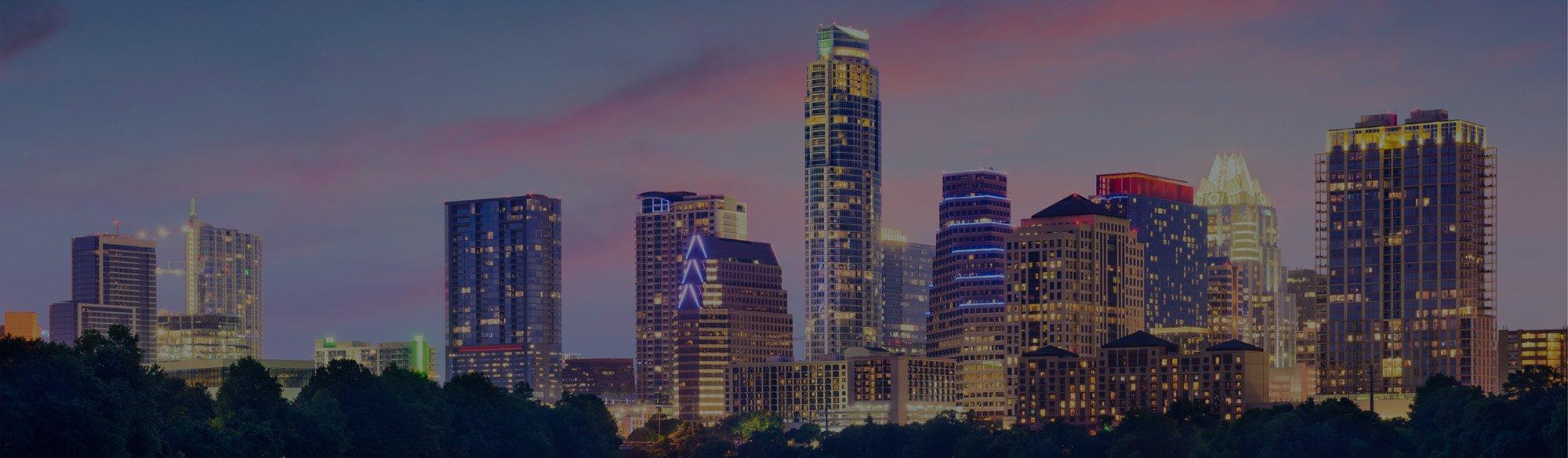 austin-skyline-lit-up-dusk-colvin-electric