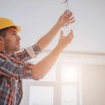 man-replacing-light-bulb-electrical-home-maintenance-tasks-colvin-electric