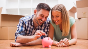 couple-saving-money-putting-coin-in-piggy-bank