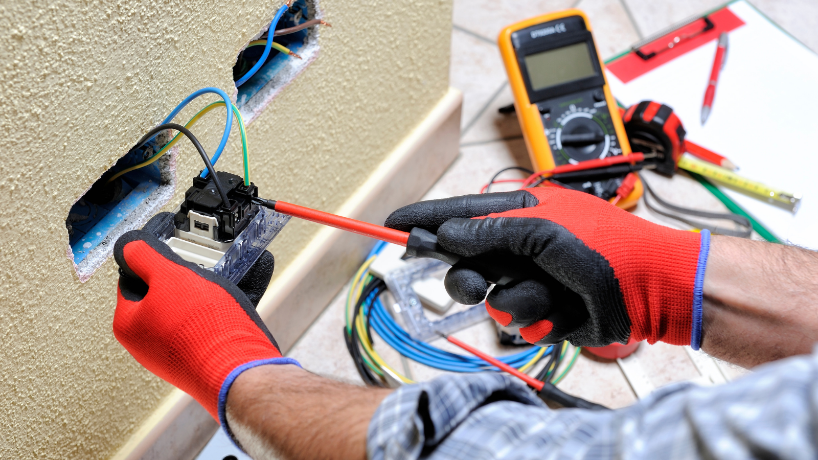 An electrician inspecting